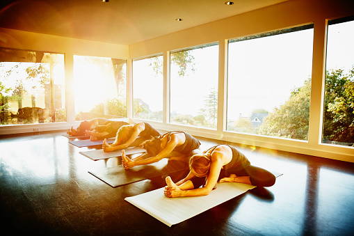 Group of women practicing yoga in studio