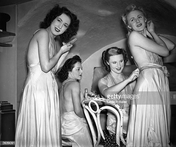 A group of women preparing for an evening out at the first wartime nightclub in London Original Publication Picture Post 237 First Wartime Nightclub...