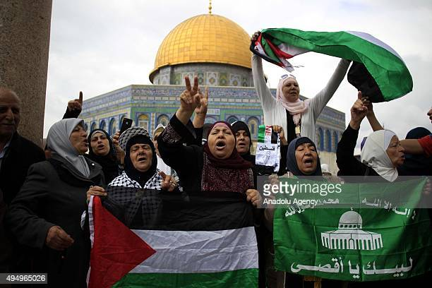 A group of women protest Israeli Government's violation over Palestinians in front of the Dome of Rock in Jerusalem on October 30 2015 Israeli...