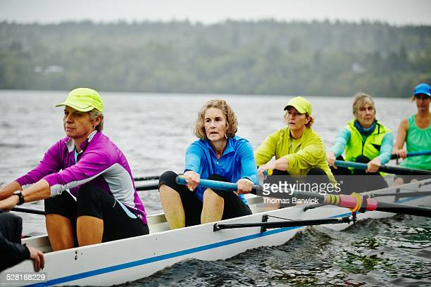Group of women rowing eight person rowing shell