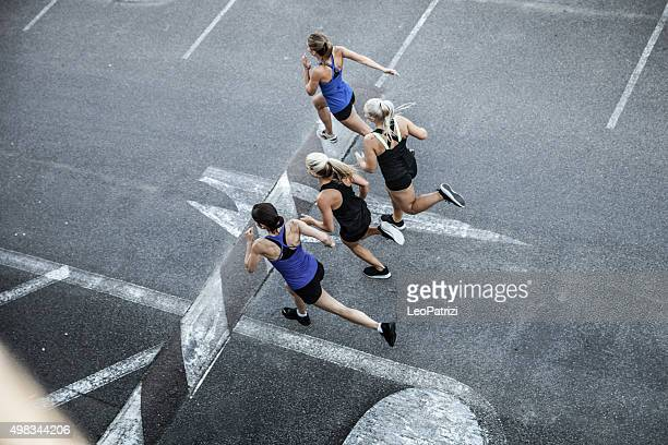Group of women running in the city