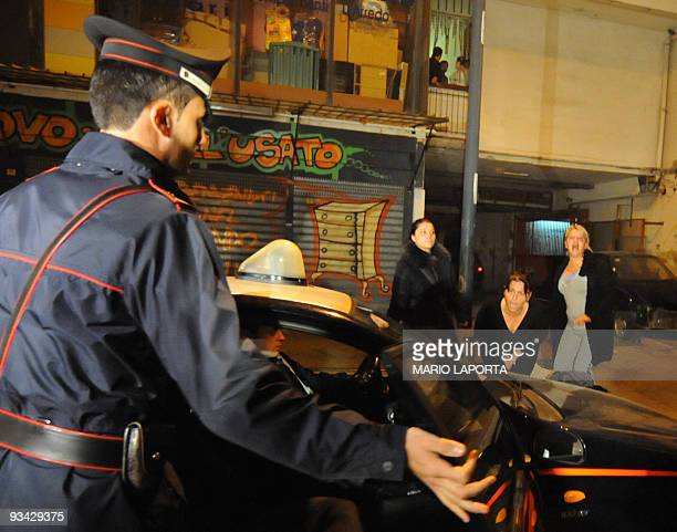 A group of women shout at Italian Carabinieri during the arrest of Giovanni Casella in Naples early on November 26 2009 Giovanni Casella is one of...