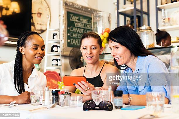 Group Of Women Sitting At A Restaurant Table