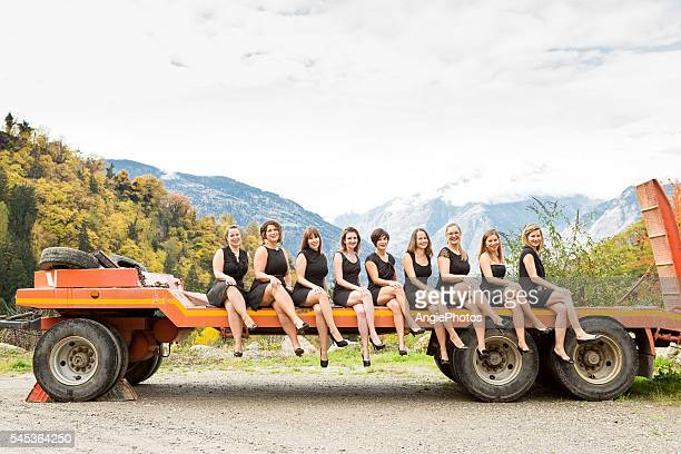 Group of women sitting on truck