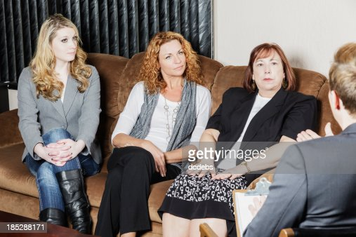 Group of Women Speak to Counselor