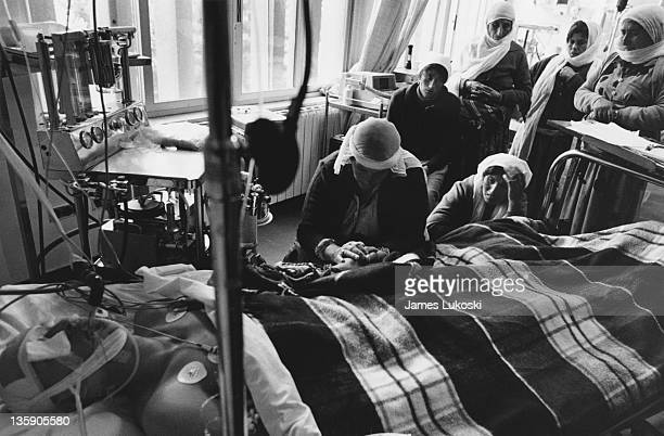 A group of women surround a patient in hospital during the IsraeliPalestinian conflict circa 1990