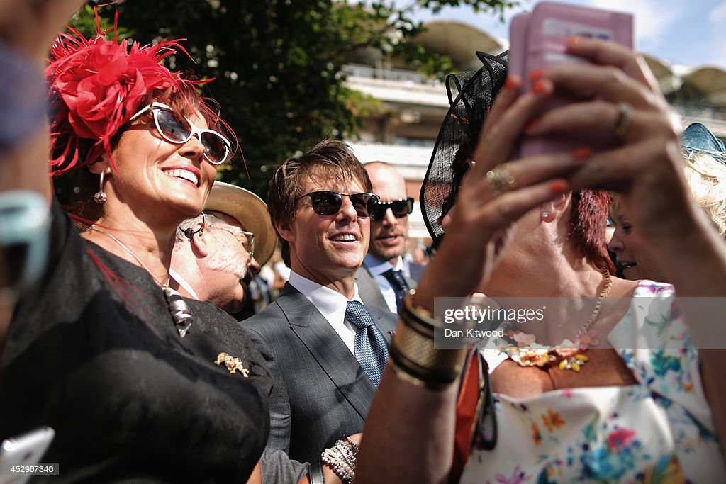 A group of women take 'selfies' with Actor <a gi-track='captionPersonalityLinkClicked' href=/galleries/search?phrase=Tom+Cruise&family=editorial&specificpeople=156405 ng-click='$event.stopPropagation()'>Tom Cruise</a> at Goodwood on July 31, 2014 in Chichester, England. Today is Ladies Day at the prestigious Goodwood Races.