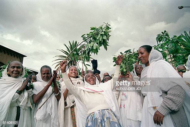 A group of women takes to the street singing and dancing 25 April 1993 in the Red Sea port of Massawa at the end of of a treeday referendum which...