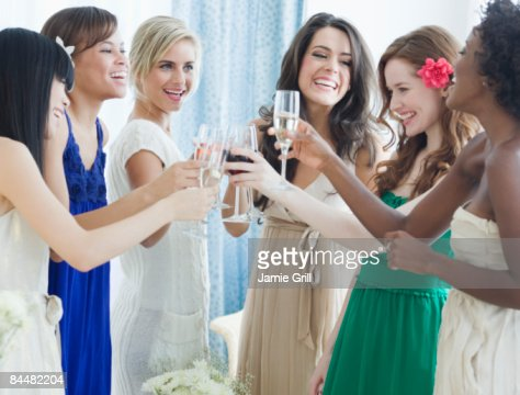 Group of women toasting at a party : Stock Photo