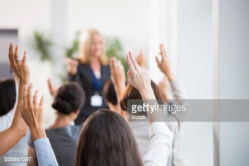 Group of women voting during seminar