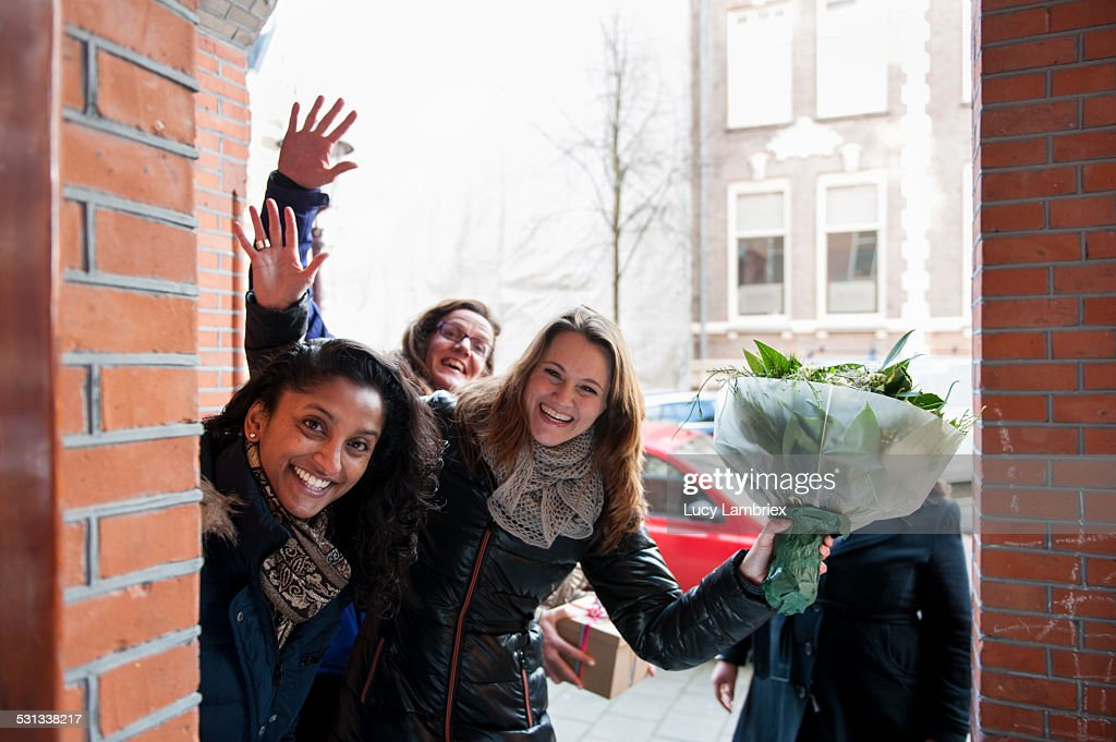 Group of women with a bunch of flowers, smiling