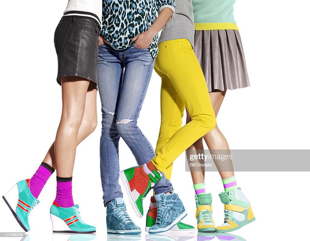 Group of women's legs all in wedge heels