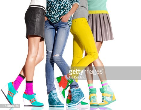 Group of women's legs all in wedge heels : Stock Photo