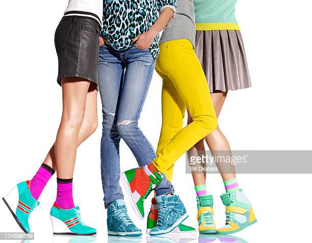 Group of women's legs all in wedge heels