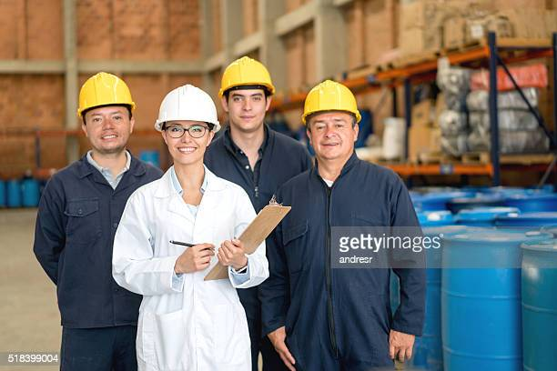 Group of workers at a chemical factory