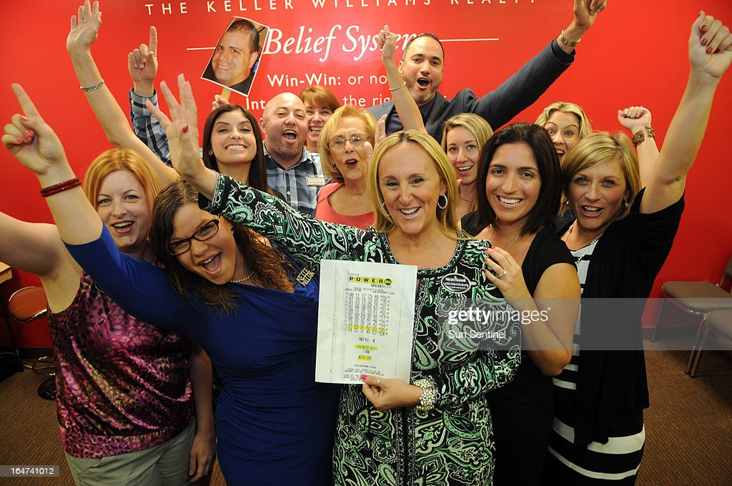 A group of workers at Keller Williams Partners Realty in Plantation are cheering with joy after they matched five Powerball numbers and won $1 million Saturday night. Realtor Laurie Finkelstein Reader, middle bought the tickets at a Mobil gas station in Pembroke Pines after collecting $20 from nearly everyone in the office. The winners: (left to right front row) Amy Kilcoyne, Saria Finkelstein, Laurie Finkelstein-Reader holding the winning lottery ticket, Jennifer Forrest and Rebecca Kennedy. Middle row: Natali Levine, Marilyn Finkelstein, Natalie Mor and Jennifer Maldonado; and in the back row: Matt Weiner holds a photo of Joey Rivero who is on vacation, Natalie West and Eric J. Ubiera.