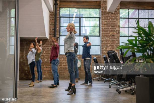 Group of workers exercising at the office