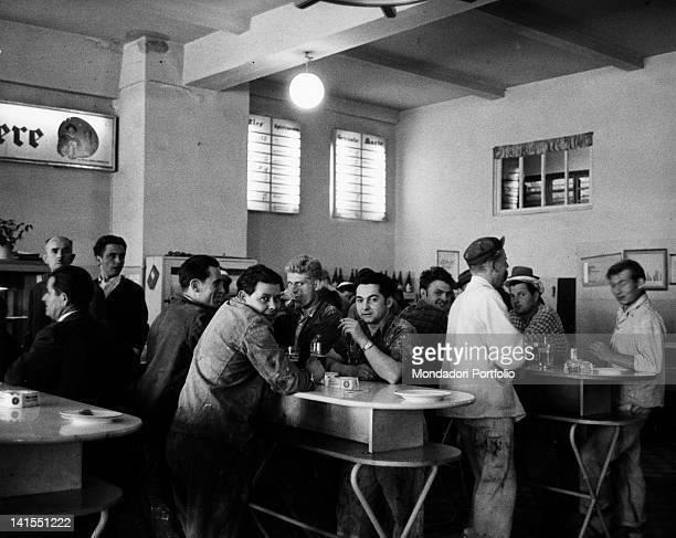 A group of workers having lunch at a selfservice restaurant in East Berlin Berlin August 1961