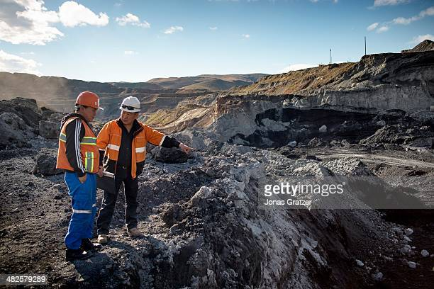 A group of workers in the Sharyn Gol coal mine discuss the mining situation for their next jobs in the Sharyngol district of Mongolia Mongolia today...