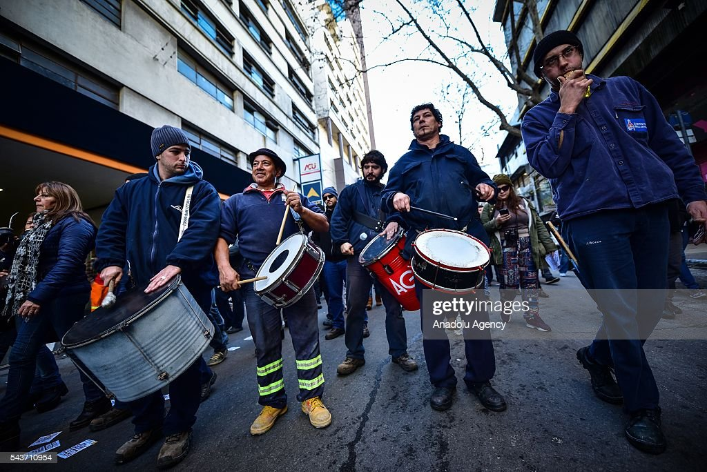 A group of workers playing drums in the march against the economic policies in Montevideo on June 29, 2016. The PIT-CNT (the only organization of unionized workers of Uruguay) today made a partial strike and marched to front the Ministry of Economy of Uruguay.