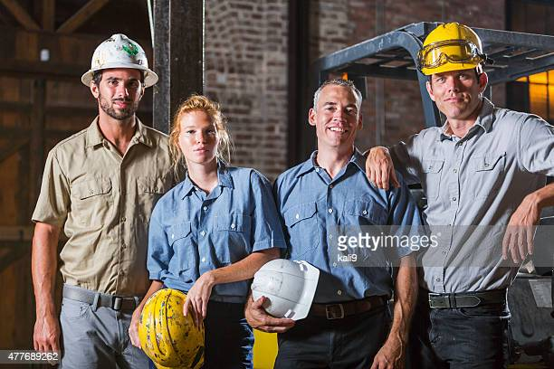 Group of workers with hardhats standing together