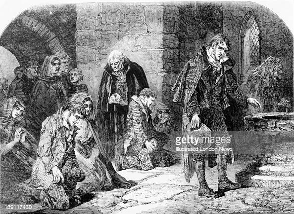 A group of worshippers praying in a chapel in the town of Thurles North Tipperary Ireland during the Great Famine 1848 Original publication...