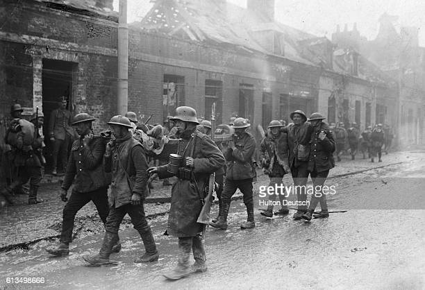 A group of wounded German and British soldiers make their way through the streets of St Quentin The Battle of the Somme was costly in terms of...