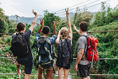 Group of young adult friends outdoors recreational leisure, freedom and adventure concept