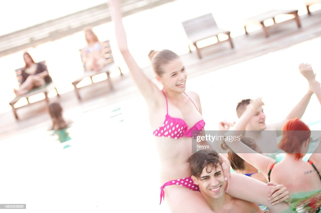 group of young adult people having fun on swimming pool : Stock Photo