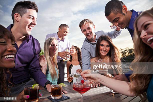 Group of young adults drinking outdoors
