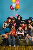 Group of young adults having birthday party
