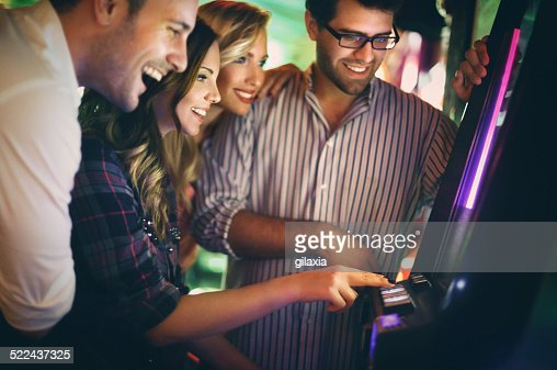 Group of young adults having fun in casino.