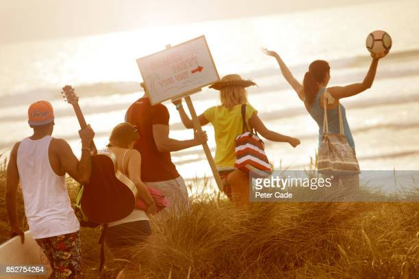 Group of young adults heading beach fro party
