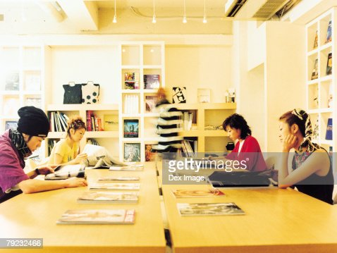 Group of young adults in reading room : Stock Photo