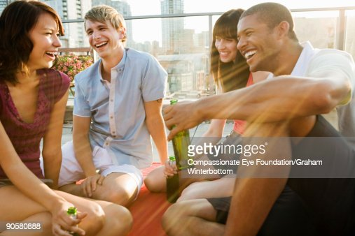 group of young adults laughing and smiling : Stock Photo
