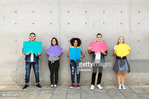 Group of young adults outdoors holding empty placard copy-space thought bubbles : Stock Photo