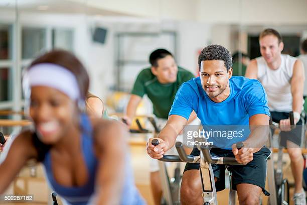 Group of Young Adults Taking a Spin Class