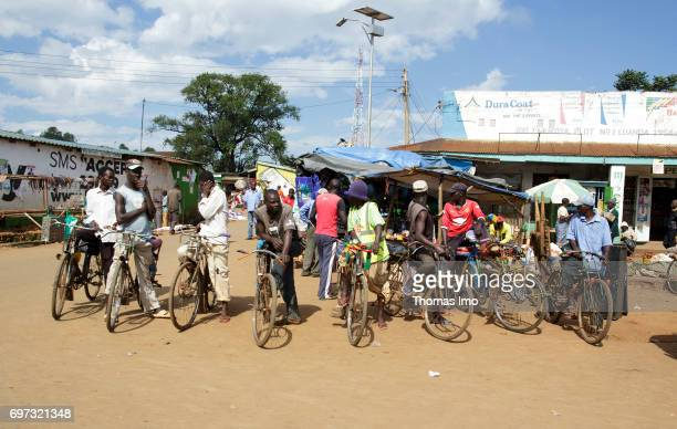 A group of young Africans stands with their bicycles on a place in Kakamega on May 16 2017 in Kakamega County Kenya