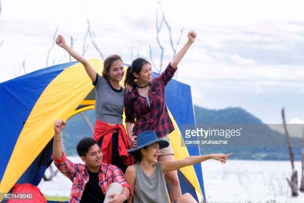 Group of Young Asian Camper Enjoy Camping Outdoors . Holiday , vacation , summer concept .