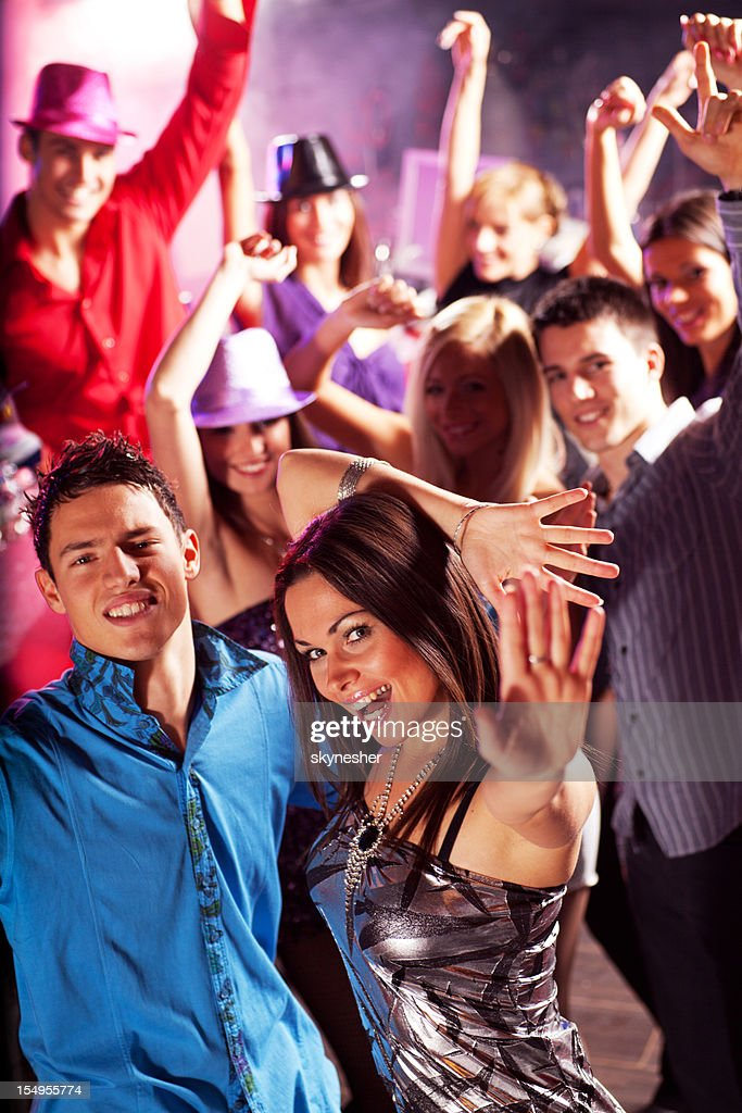 Group of young boys and girls enjoying at nightclub. : Stock Photo