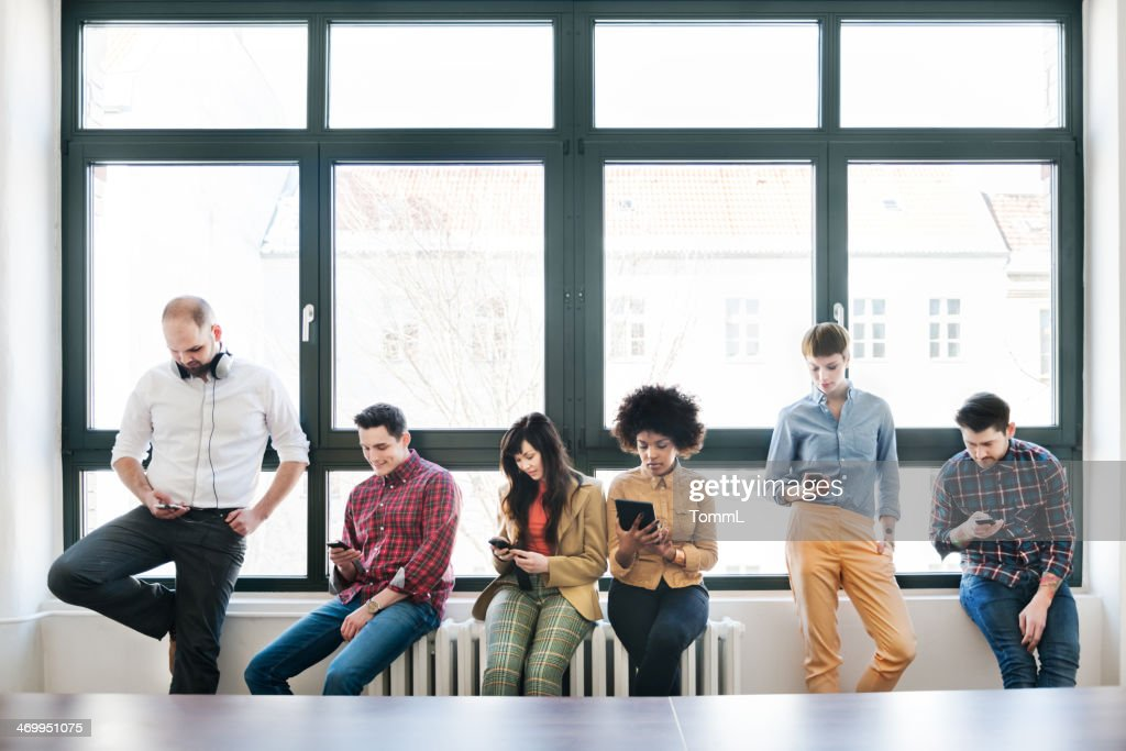 Group Of Young Business People With Smart Phones