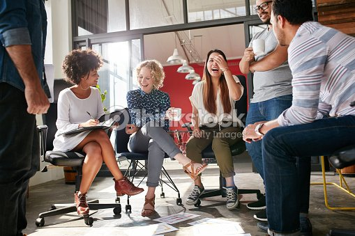 Group of young business professionals having a meeting : Stock Photo