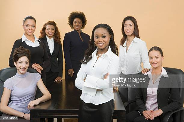 Group of young business women, smiling, portrait