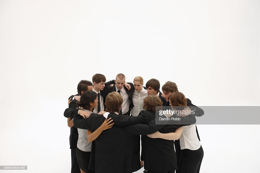 Group of young businesspeople standing in circle, elevated view : Stock Photo