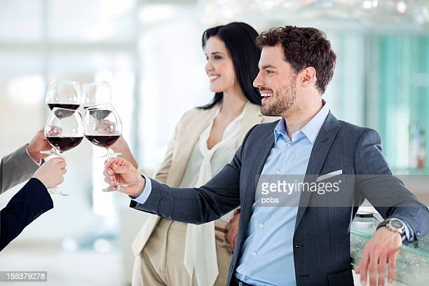 Group of young businesspeople,work colleagues toasting in restaurant
