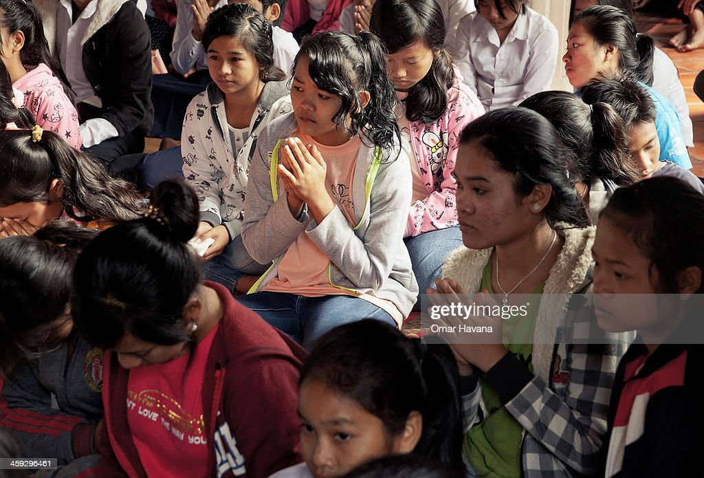 A group of young catholic girls attend the Christmas day mass at the church of Our Lady of the Assumption on December 25, 2013 in Battambang, Cambodia. The parish at Battambang dates back to 1790 when the Catholic community first arrived. Now they serve around 1000 Catholics and 600 families.