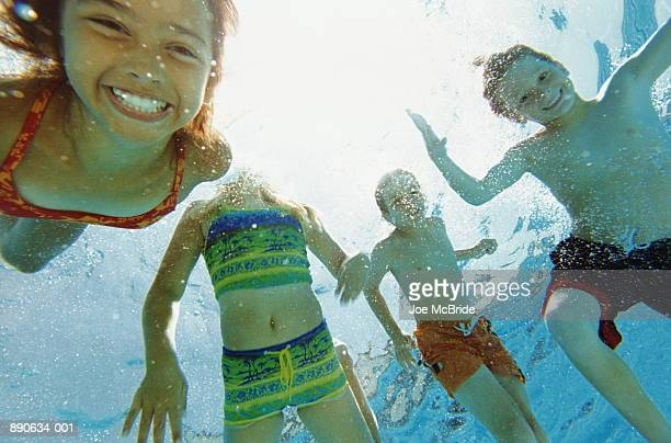 Group of young children (8-10) in swimming pool, underwater view