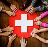 A group of young children learning about first aid
