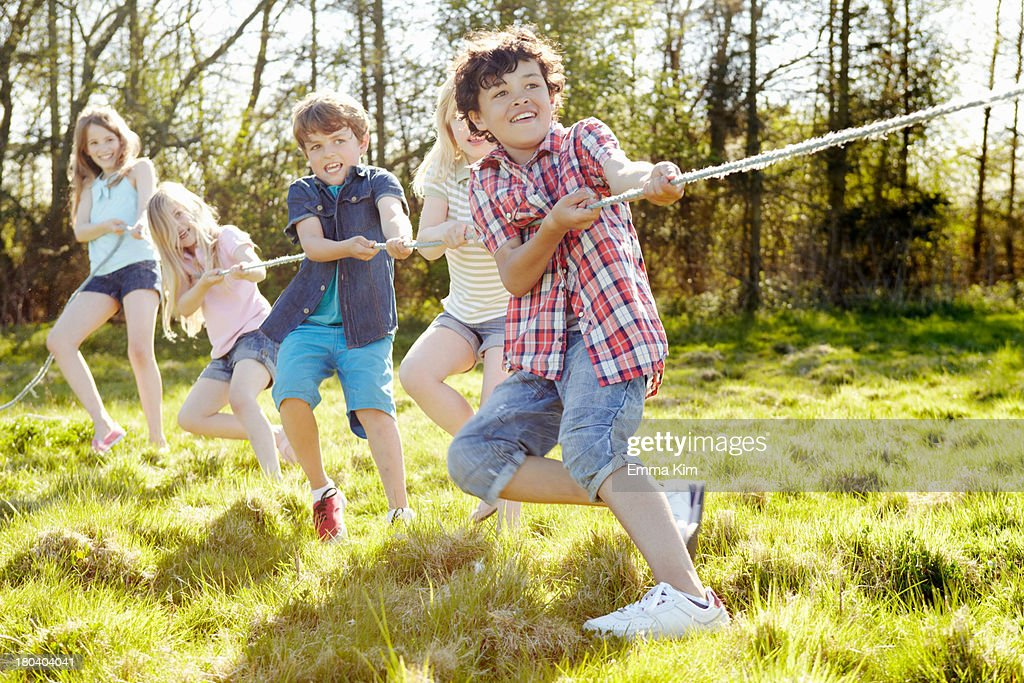 Group of young children playing tug o war