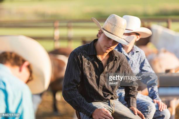 Group of Young Cowboys Waiting and Watching at a Rodeo